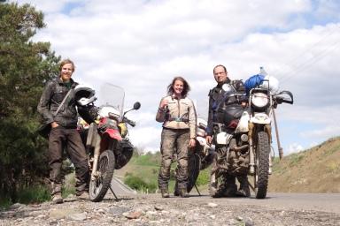 Massive Russian man on a tiny motorbike