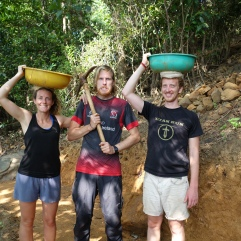 3 workaway volunteers being busy in the jungle
