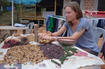Denise sifting through civet poo coffee beans